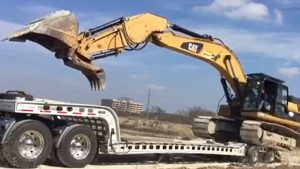 Murray Trailers | Pro with 336D Excavator Loaded over back
